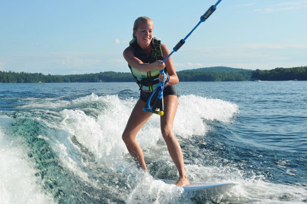 Christina Lake Motel and RV Park - Things To Do In Christina Lake - Girl Surfing Behind A Boat